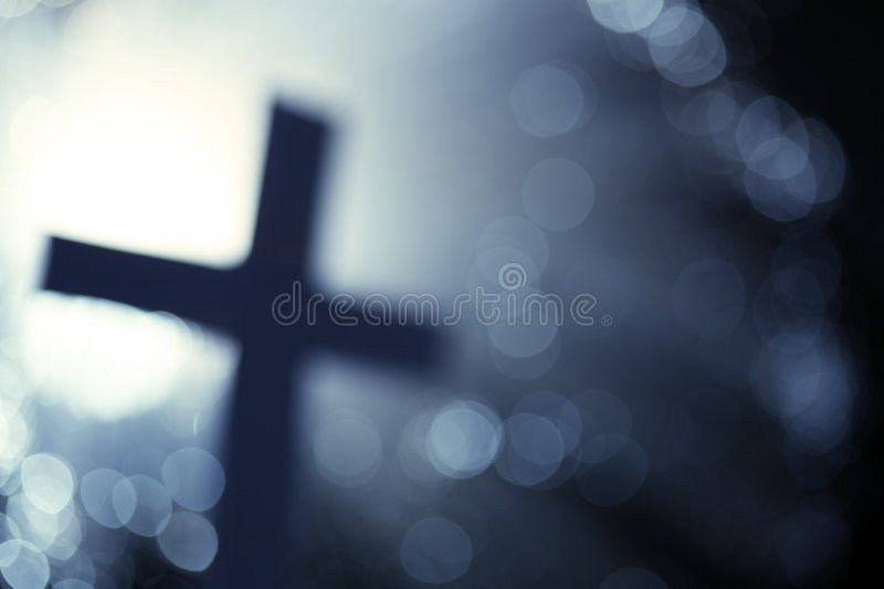 Abstract cross. Silhouette in blue stock photography