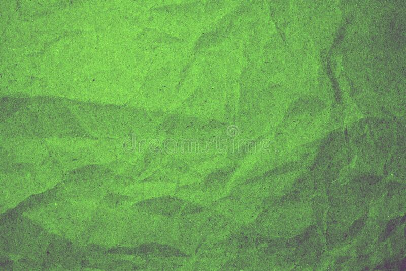 Abstract crumpled green paper background stock images