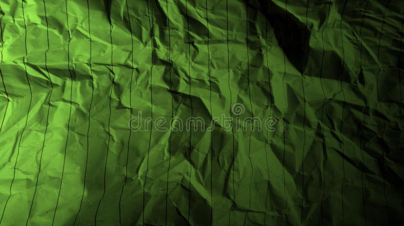 Abstract crumpled paper black avocado green color mixture multi colors effects background. royalty free stock photo