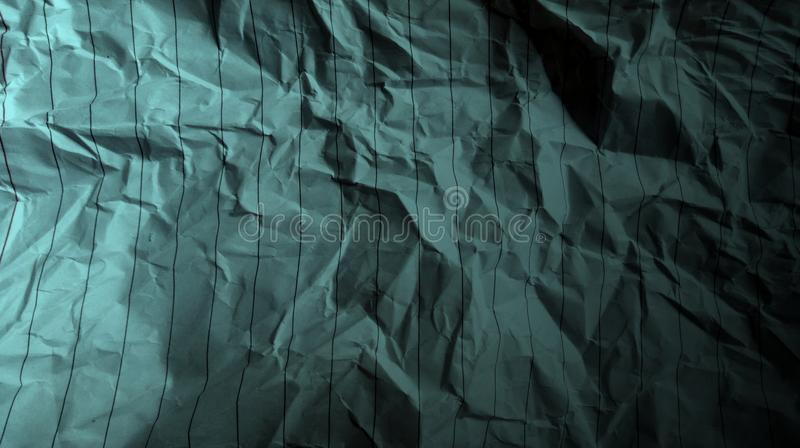 Abstract crumpled paper black ocean green color mixture multi colors effects Background. stock photos