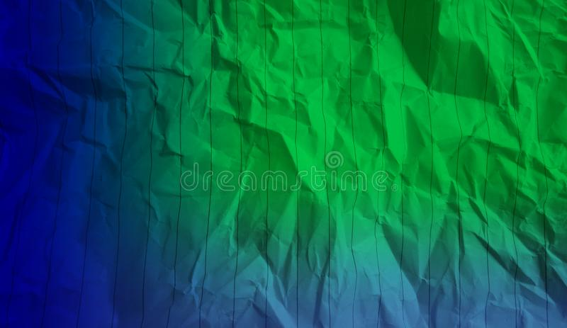 Abstract crumpled paper deep navy blue pastel blue green color mixture multi colors effects background. stock photography