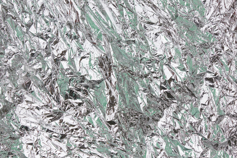 Abstract crumpled silver aluminum foil closeup background texture royalty free stock photo