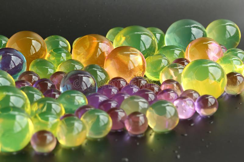 Abstract background with colorful hydrogel orbeez balls royalty free stock photos