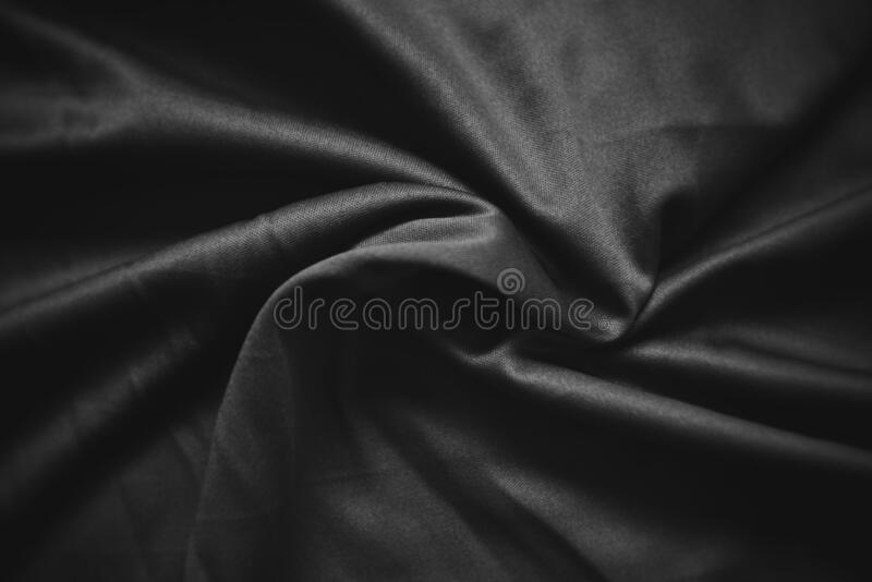 Abstract dark black crumpled fabric texture background - Smooth elegant black silk , satin luxury cloth wave. Abstract dark black crumpled fabric texture royalty free stock photos