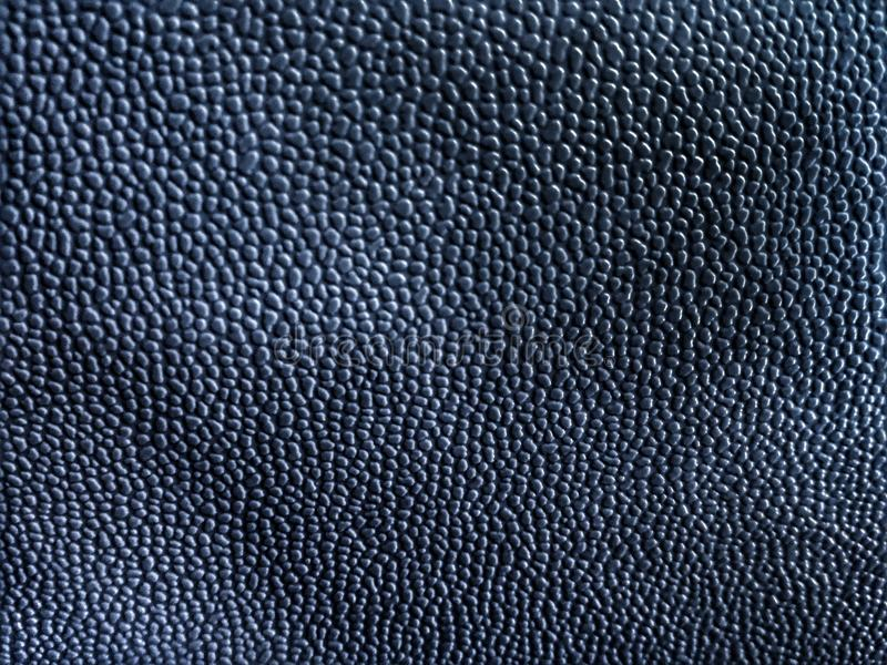 Abstract dark black gray colored background of elegant skin or plastic. Abstract black gray and dark colored background of elegant grundge texture with light royalty free stock images