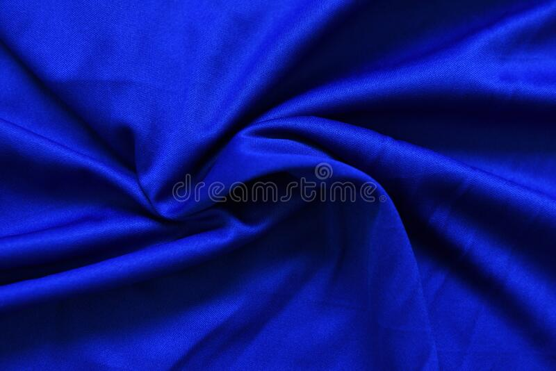 Abstract dark blue crumpled fabric texture background - Smooth elegant blue silk , satin luxury cloth wave. Abstract dark blue crumpled fabric texture background stock image