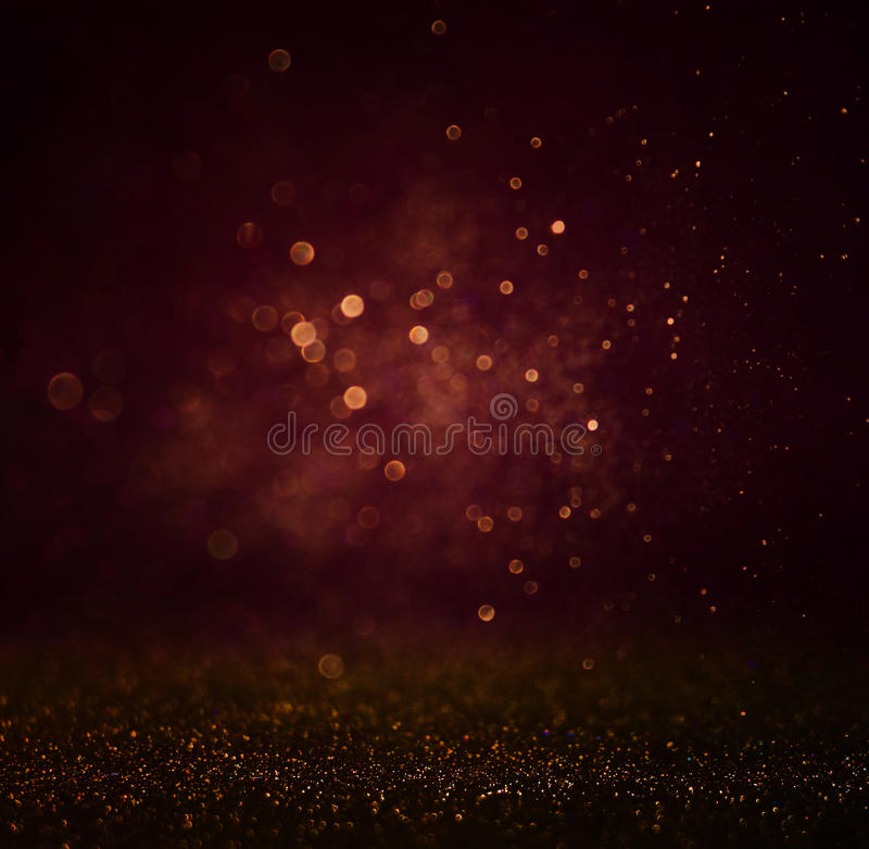 Abstract dark bokhe lights background , purple,black and subtle gold. defocused background royalty free stock photo