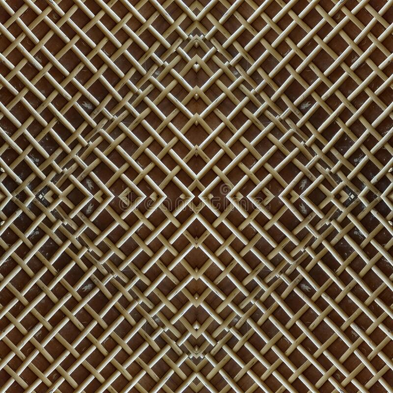 Abstract dark brown wall panel with centered net pattern. Antique weathered brown wooden panel, with abstract symmetrical centered nets rhombus pattern cover stock photography