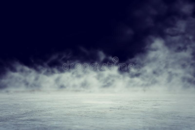 Abstract dark concentrate floor scene with mist or fog, spotlight and display.  royalty free stock photos