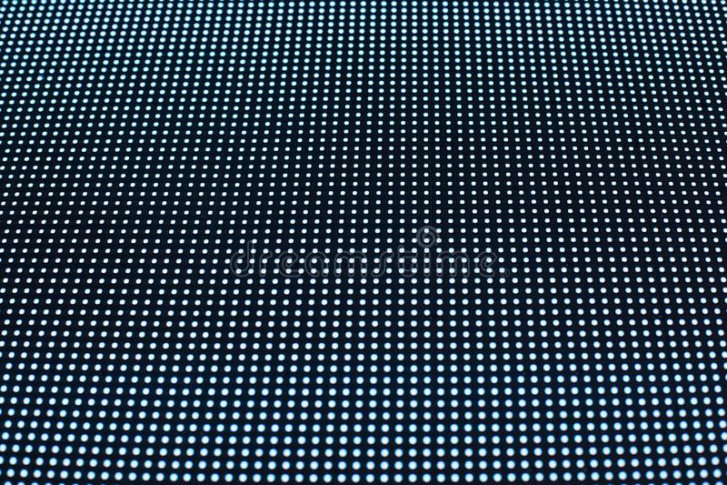 Abstract dark dotted texture background, many small blue neon round dots lights on black backdrop, decorative polka dot ornament. Abstract dark dotted texture stock images