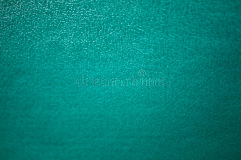 Abstract dark emerald green texture. Ribbed fabrics leather background. Old vintage cloth royalty free stock photos