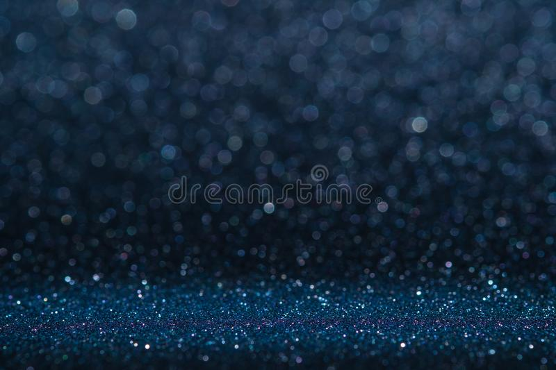 Abstract dark navy blue sparkling glitter wall and floor perspective background studio with blur bokeh.luxury holiday backdrop mo royalty free stock photos