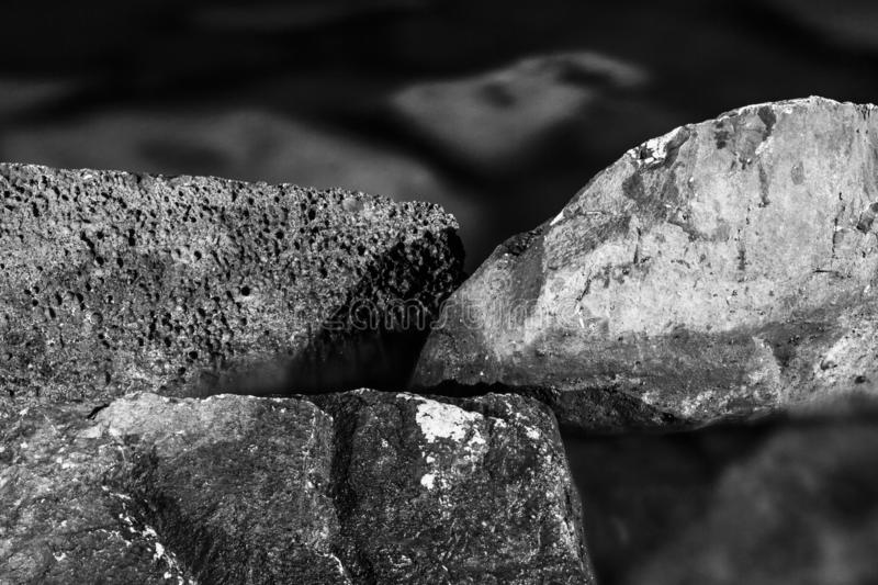 Abstract, dark, organic composition of stones immersed in sea water . royalty free stock photography