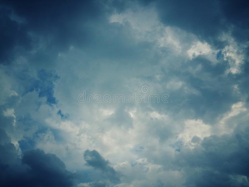 Abstract and dark tones with blue skies. And gray clouds for natural backgrounds royalty free stock images