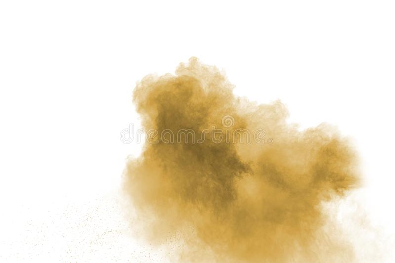 Abstract deep brown dust explosion on white background.  Freeze motion of coffee liked color dust splash royalty free stock photo