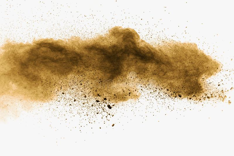 Abstract deep brown dust explosion on white background.  Freeze motion of coffee liked color dust splash royalty free stock images