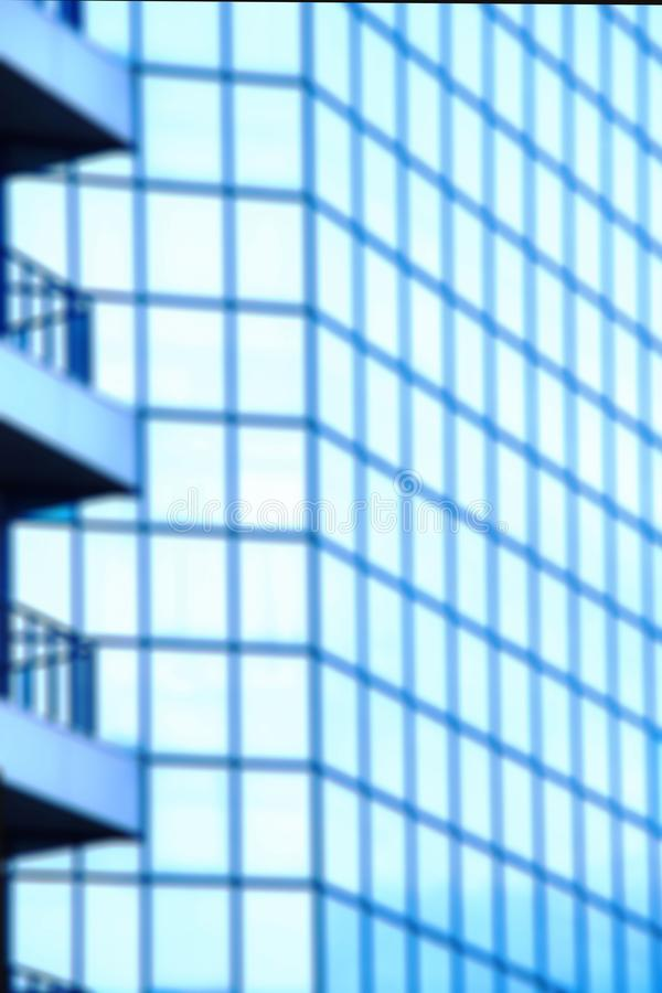 Abstract defocused background.A high-rise office building with blue glass windows royalty free stock images