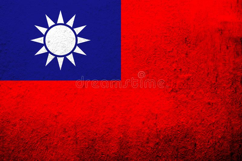 The Republic of China Taiwan National flag `Blue Sky, White Sun, and a Wholly Red Earth`. Grunge background royalty free stock image