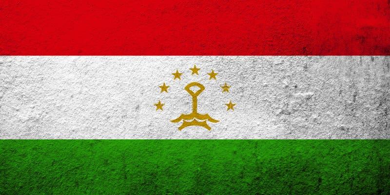 The Republic of Tajikistan National flag. Grunge background stock image