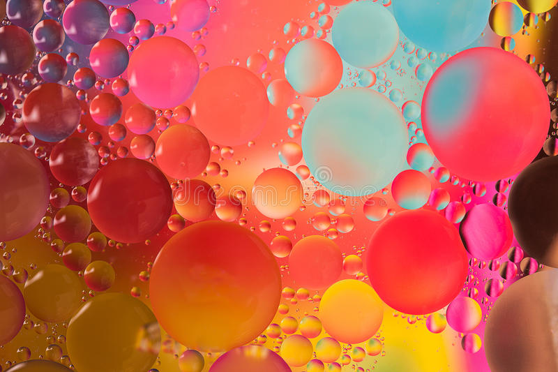 Abstract design of oil drops on water stock images