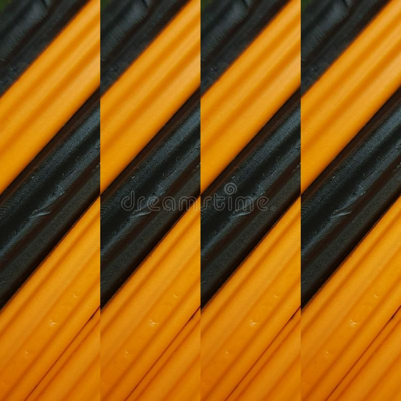 Abstract design with pieces of plasticine bars in colors orange and black, background and texture. Backdrop for color-related announcements, school material for royalty free stock images
