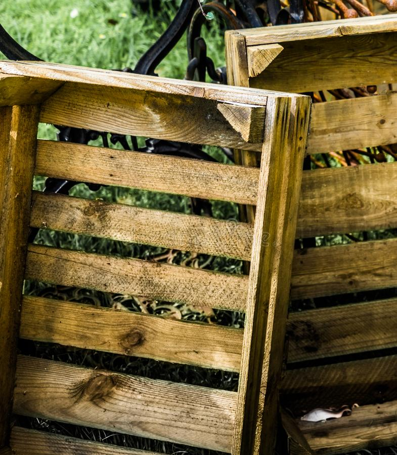 Abstract developed picture of two old ugly empty cheap wooden boxes royalty free stock photography