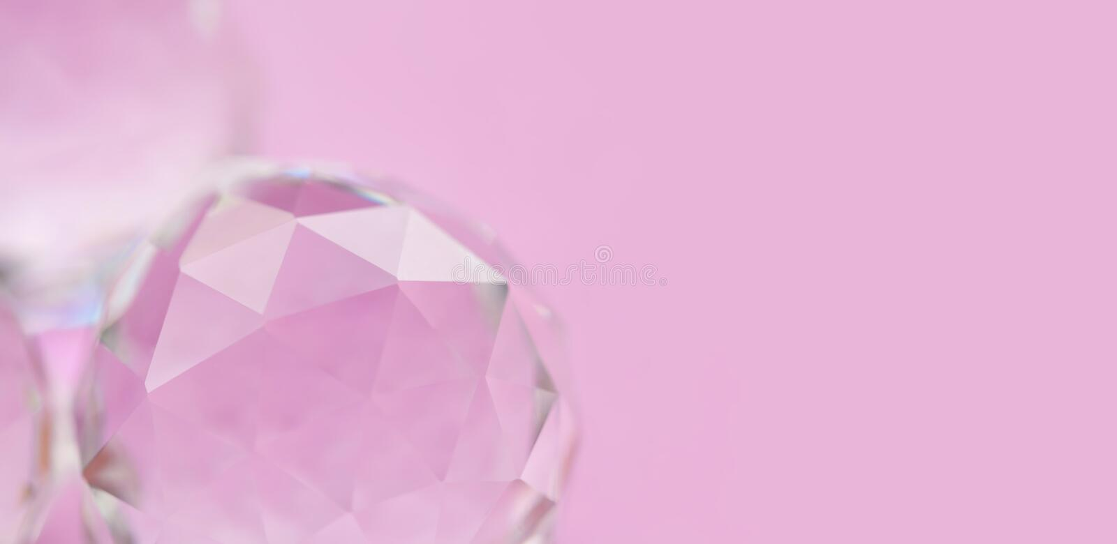 Abstract diamond stone on pink background. Beautiful crystal gem, geometric polygon shapes. Macro view, shallow depth of royalty free stock photography