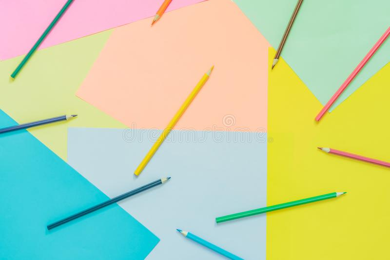 Abstract different multicolored trendy neon backgrounds with pencils and place for text. Top view stock photography