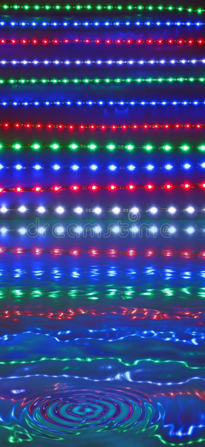 Abstract disco lights reflected in water, discotheque royalty free stock photo