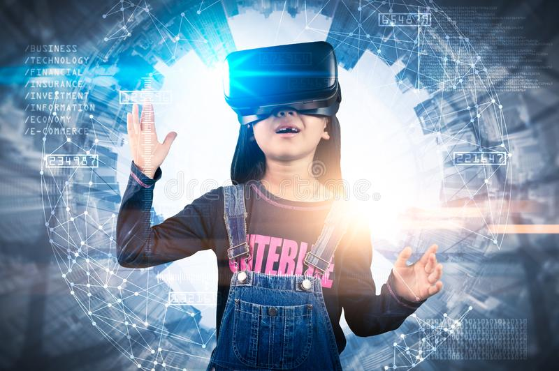 The abstract double exposure image of the girl using smart glasses or VR glasses overlay with virtual hologram image. the concept royalty free stock photos