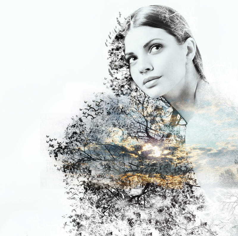 Abstract double exposure of woman and beauty of nature at the su. Double exposure of attractive woman and beauty of nature, abstract concept royalty free stock photography