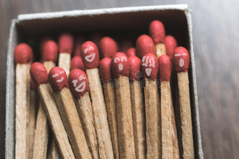 Abstract draw smiley face on Matches in a box best friend concept. stock image