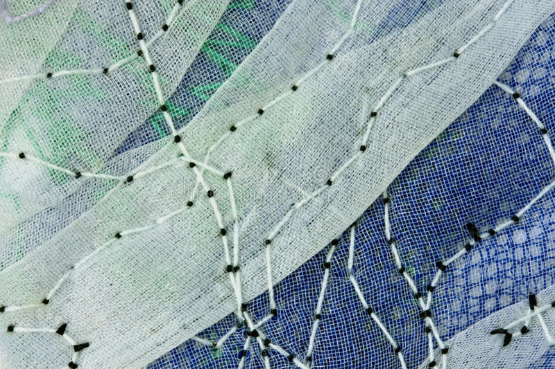 Abstract embroidery. Detail of an abstract work of embroidery mostly in blue and green stock images