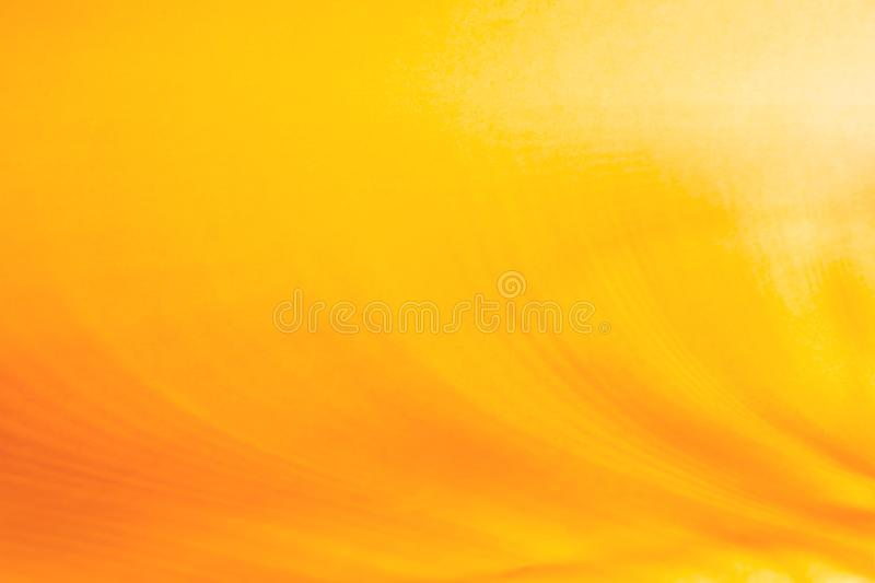 Abstract empty graphic background of orange yellow and gold color with a gradient from lighting effect with copy space for text. royalty free stock images