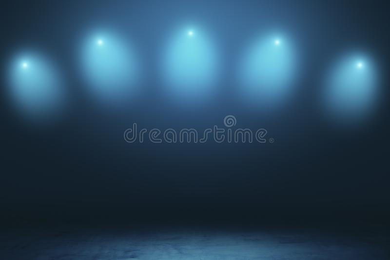 Abstract empty stage in dark hall with blurry spotlights and dark concrete floor stock photography