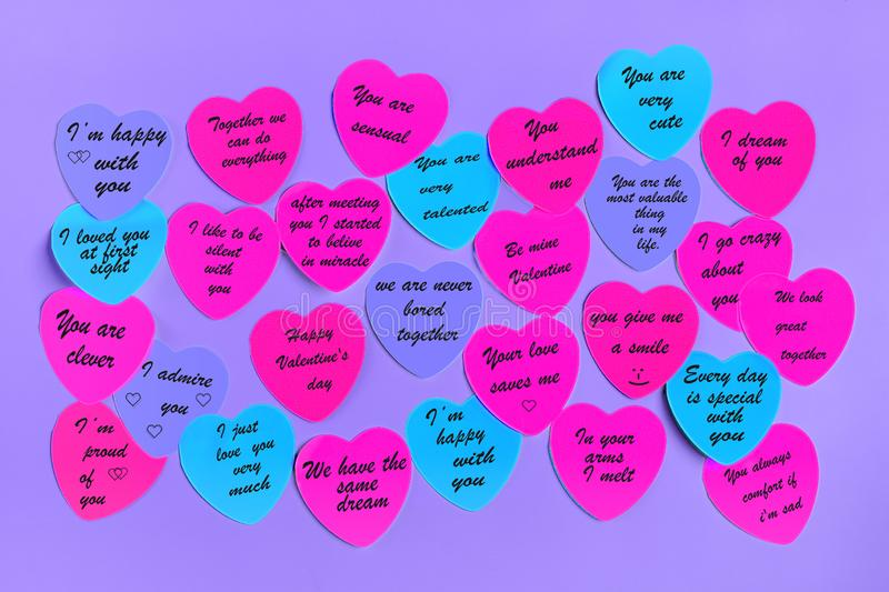 Abstract empty sticky note in the shape of a heart magnet on pink board. Valentine greeting card message.Happy Valentine`s day concept. Flat lay. Top view stock images