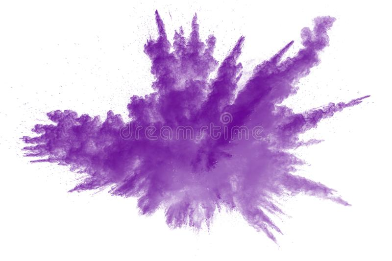 Abstract explosion of purple dust on white background. Abstract purple powder splatter on white background. Freeze motion of purple powder splash stock photo