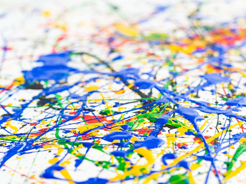 Abstract expressionism art creative background. art of splashes and drips . red black green yellow blue paint on white background royalty free stock photos