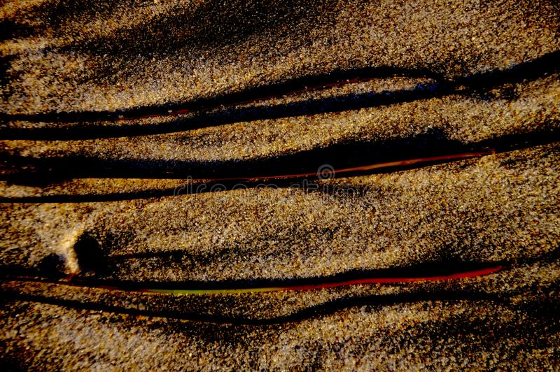 Abstract extreme close-up of beach sand, furrows and shadows royalty free stock photography