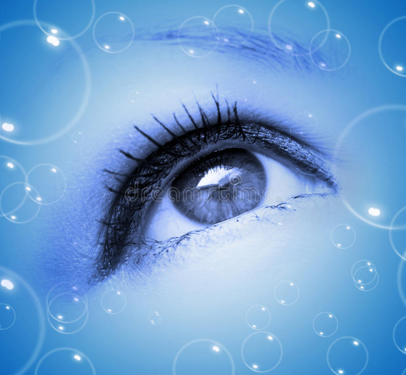 Abstract eye with bubbles stock images