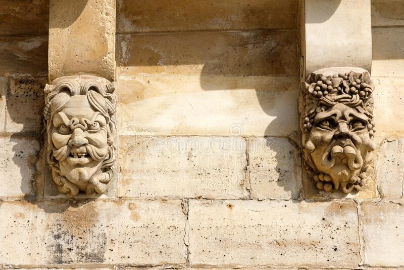 Abstract facial carvings royalty free stock photo