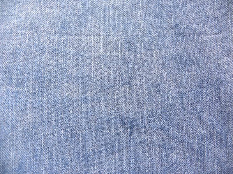 Abstract faded blue denim jeans texture background royalty free stock images