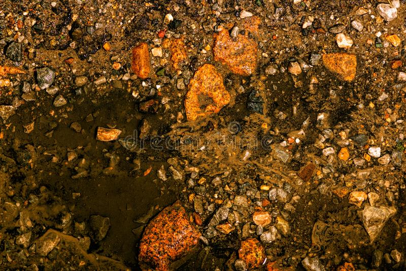 The texture consisting of multi-colored stones and water. Contrast image of fantastic landscape. stock photography
