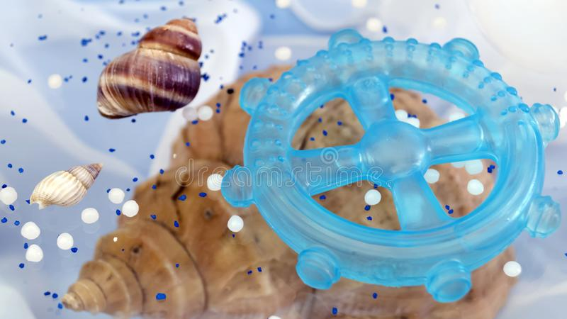 Abstract fantasy background on the sea theme with shells. And blue steering wheel royalty free stock photos