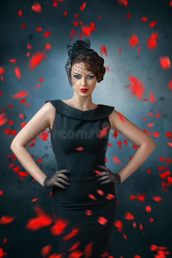 Abstract fashion portrait of young woman with flame. And smoke over dark background royalty free stock images