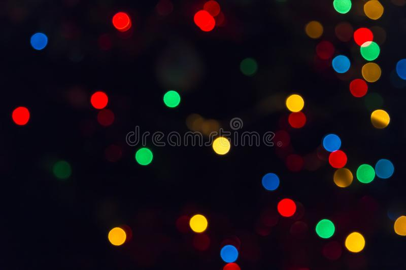 Abstract festive New Year Christmas defocused background with bokeh multicolored effect on black background with copy space stock photos