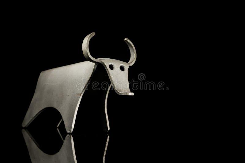 Abstract figurine of a bull made of bent aluminium sheet stock photo