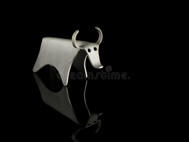 Abstract figurine of a bull made of bent aluminium sheet royalty free stock images
