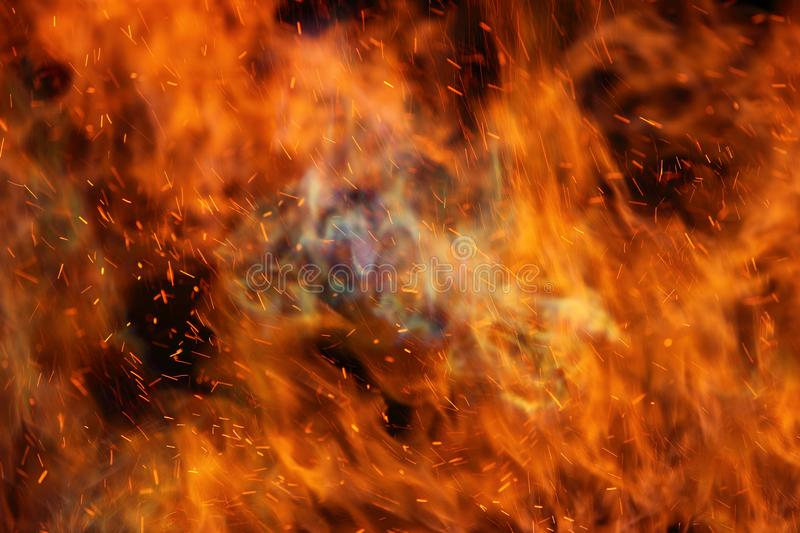 Abstract fire flames in dark area. Abstract fire flames in dark background royalty free stock images
