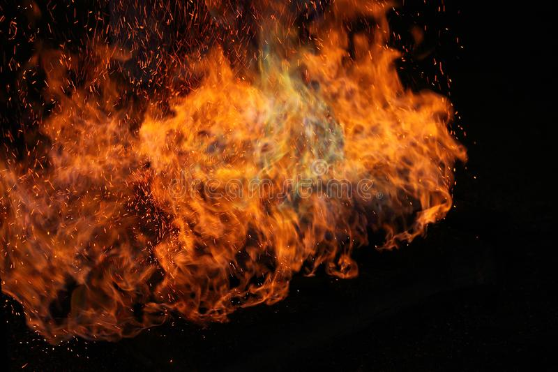 Abstract fire flames in dark area. Abstract fire flames in dark background stock images